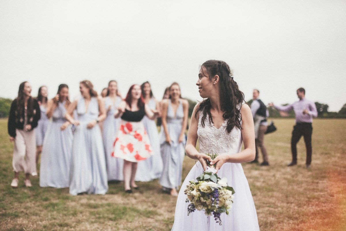bride-throwing-flowers-natural-wedding-photography