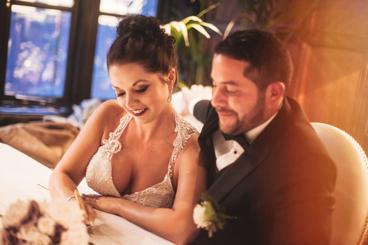 couple-signing-documents-wedding-photography