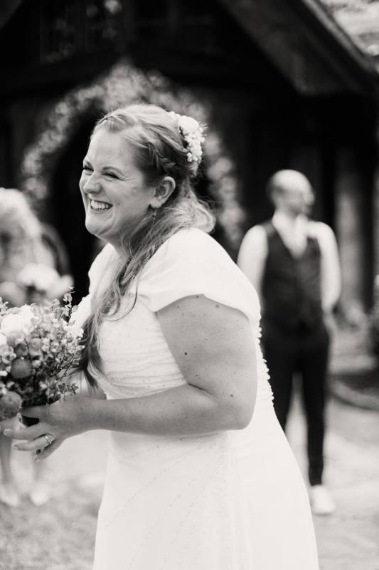 happy-bride-pre-ceremony-uk-wedding-photographer