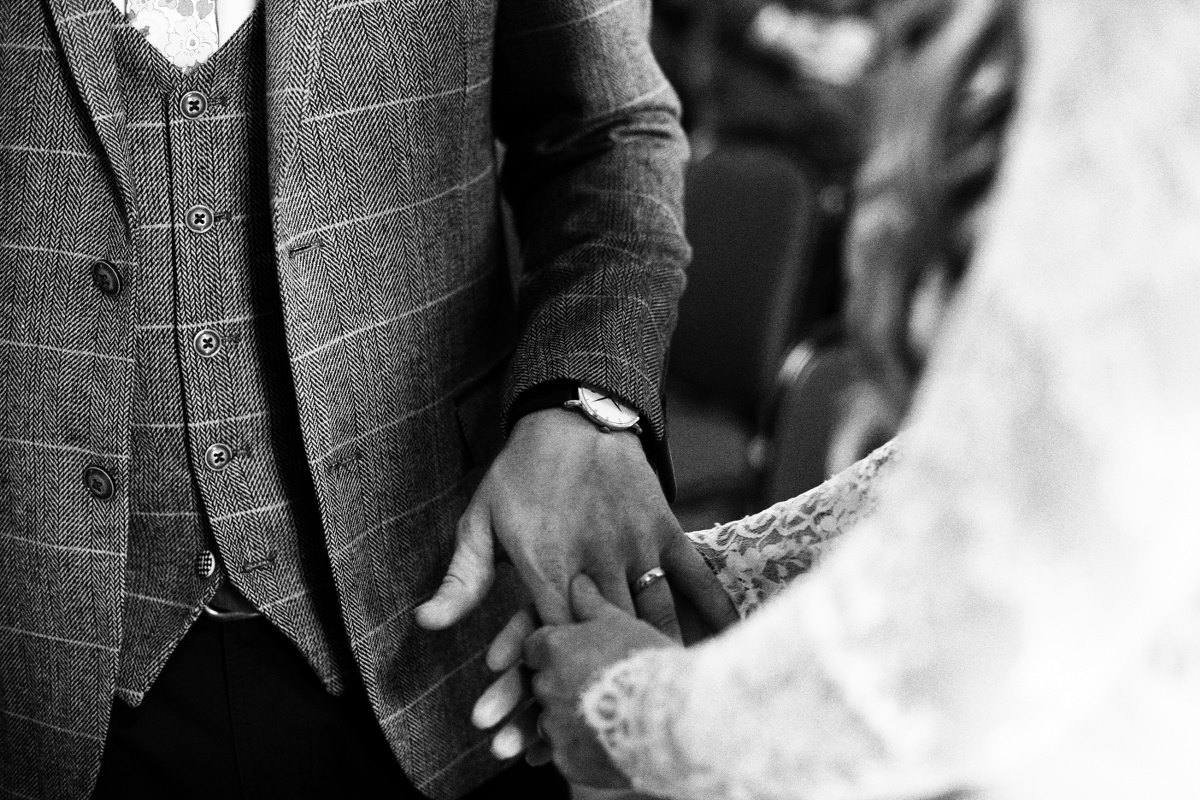 holding-hands-wedding-ceremony