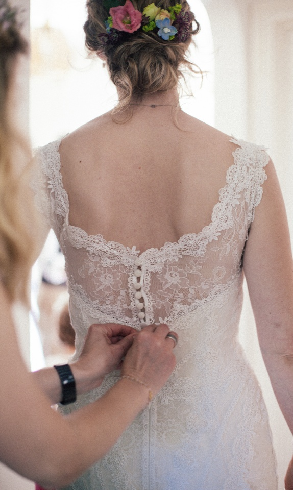 wedding-dress-being-done-up